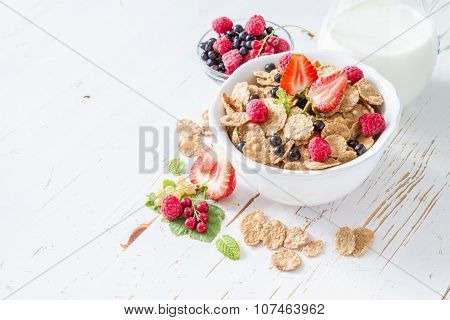 Breakfast - cereal and berries in white bowl