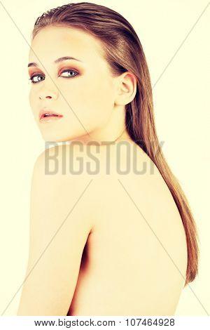 Beautiful caucasian's head and shoulders. Closeup.