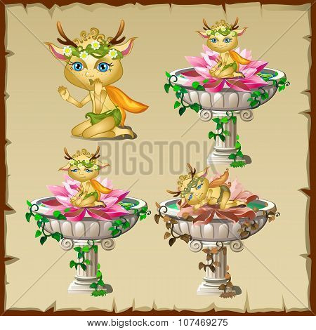 Set of three antique vases with gold elf figure