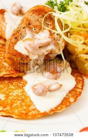 potato pancakes with meat sauce