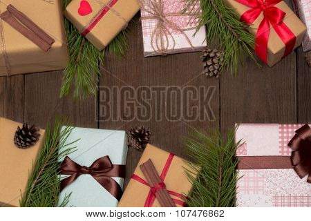 Christmas Composition With Nine Presents, Fir Tree And Pine Cones On Wooden Background With Copyspac