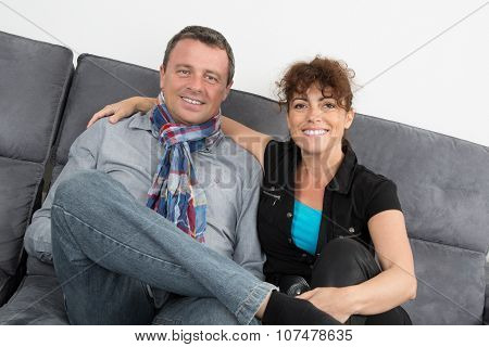 Woman With A Blue Top Smiling And Man Relaxing