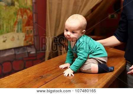 Baby Boy Sitting On The Bar