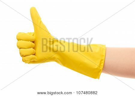 Close up of female hand in yellow protective rubber glove showing thumbs up sign