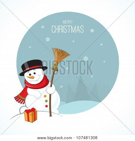 Christmas snowman on winter landscape background