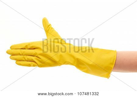 Close up of female hand in yellow protective rubber glove giving for handshake against