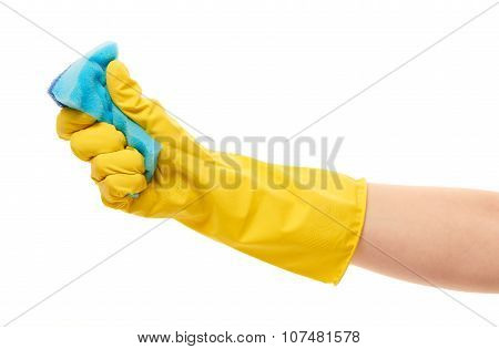 Close up of female hand in yellow protective rubber glove squeezing blue cleaning sponge