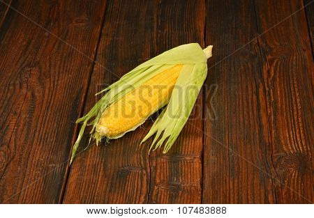 One Open Corn Cob On Vintage Wooden Surface