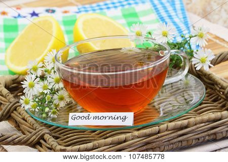 Good morning card with cup of chamomile tea, chamomile flowers and lemon