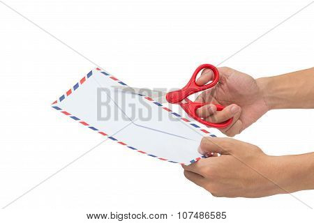 Cutting an envelop With Scissors Isolated On A White Background