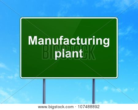 Manufacuring concept: Manufacturing Plant on road sign background