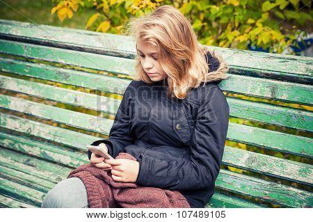 Beautiful Caucasian Blond Teenage Girl With Phone