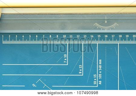 A paper guillotine, paper cutter with measuring features
