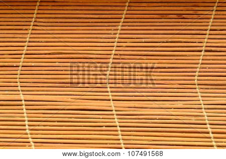 Bamboo curtain texture. Bamboo sunblind with white stitches.