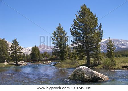 Hikers crossing Tuolumne river, Yosemite