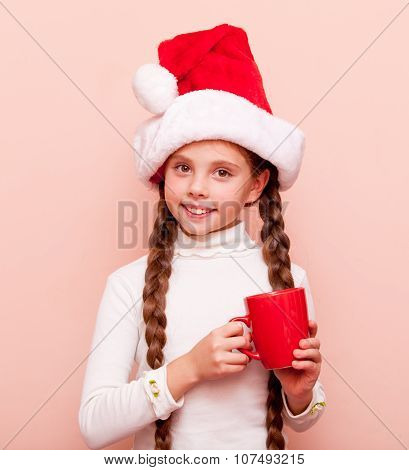 Girl With Cup In Santa Claus Hat