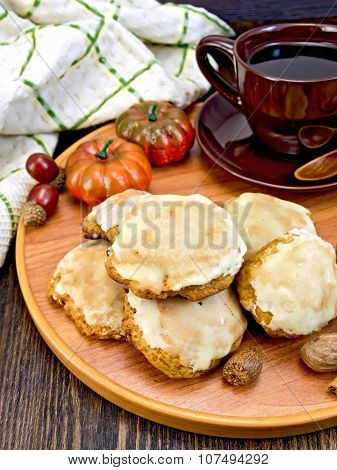 Cookies pumpkin with cup on tray