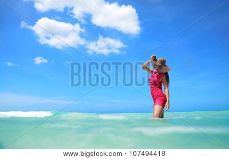 Carefree Young Woman Enjoying Clear Water Of The Carribean Sea