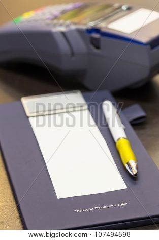 The Word Thank You On Credit Card Receipt Writing Pad With Blank Paper And Credit Card Machine In Ba