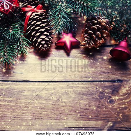 Christmas Fir Tree With Decoration On Dark Wooden Board In Vintage Style. Gold And Red Christmas Orn