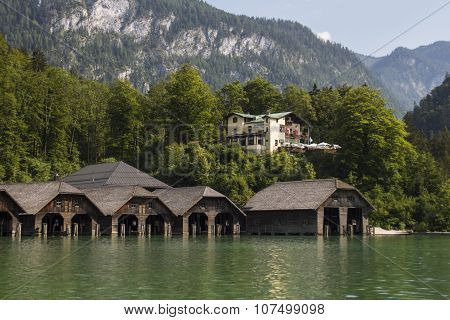 KOENIGSSEE, GERMANY - AUGUST 13, 2015: Boathouses at the Koenigssee lake for pleasure boats which commute between Schoenau St. Bartholomew and Salet