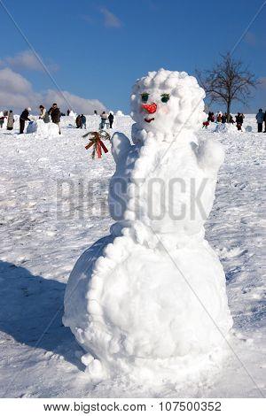 Big Snowman On Sky Background