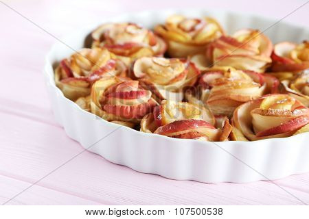 Fresh Puff Pastry With Apple Shaped Roses On Pink Wooden Table