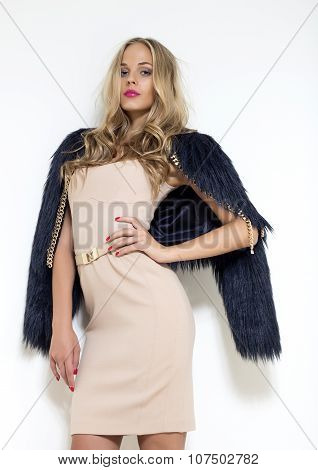 Awesome beautiful smiling blonde woman in black fur coat stylish evening elegant dress posing on whi