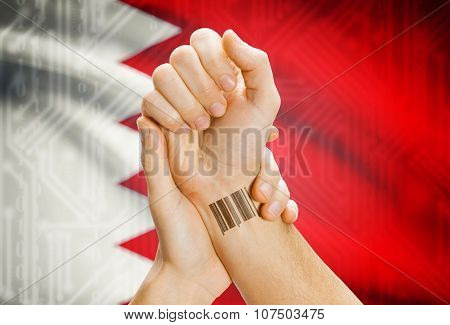Barcode Id Number On Wrist And National Flag On Background - Bahrain