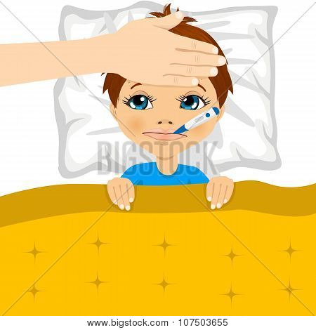 little boy ill in bed with thermometer in mouth