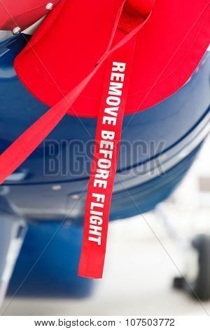 remove before flight on the aircraft fuselage