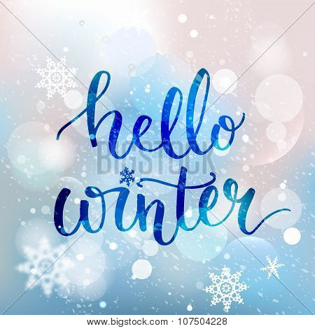 Hello winter text. Brush lettering at blue winter background with snowflakes and bokeh lights. Vecto
