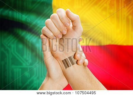 Barcode Id Number On Wrist And National Flag On Background - Benin