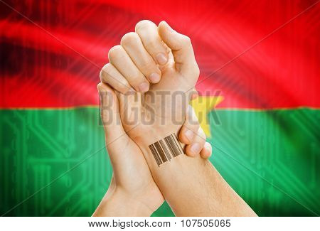 Barcode Id Number On Wrist And National Flag On Background - Burkina Faso