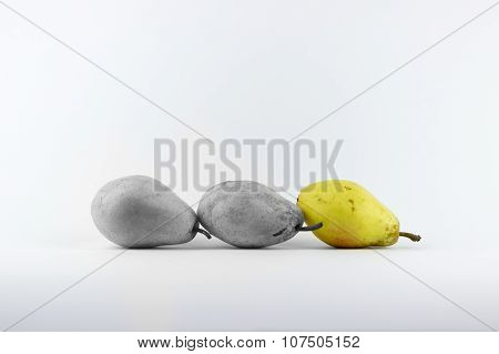 Three Pears On A White Background