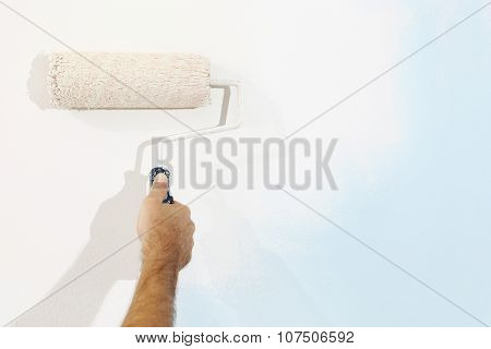 Hand Painter Man At Work With A Paint Roller, Wall Painting Concept