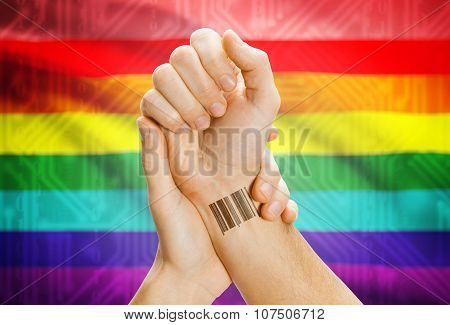 Barcode Id Number On Wrist And National Flag On Background - Lgbt People