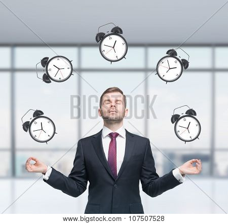 Meditative Businessman Is Pondering About Time Management In The Modern Panoramic Office. The Person