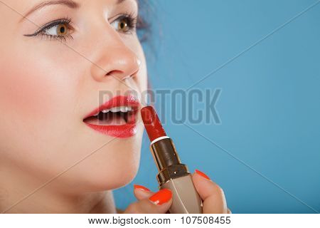 Part Of Face. Woman Applying Red Lipstick