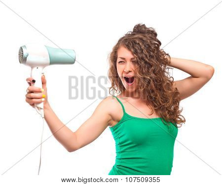 Portrait Of Young Woman Using Hairdryer