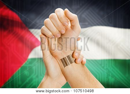 Barcode Id Number On Wrist And National Flag On Background - Palestine