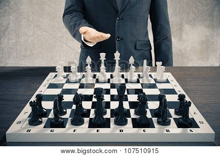 Businessman Invites To Play A Chess