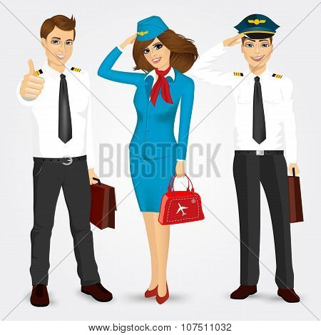 pilot and two stewardesses in uniform