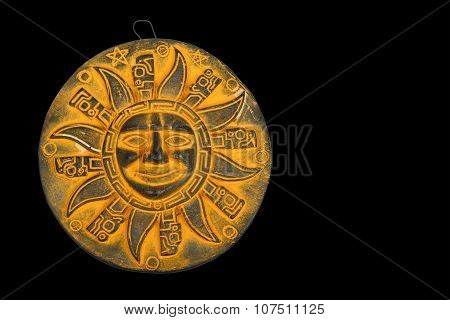 Mexican Yellow Ceramic Sun Souvenir Isolated On Black