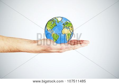 Man's Hand Holding A Globe