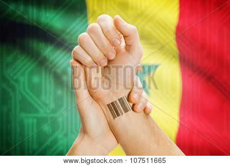Barcode Id Number On Wrist And National Flag On Background - Senegal