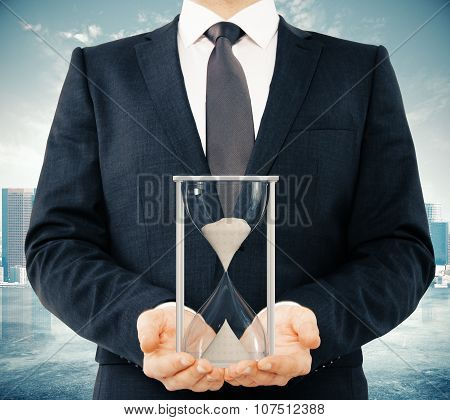 Businessman With Sandglass In The Hands, Time Concept
