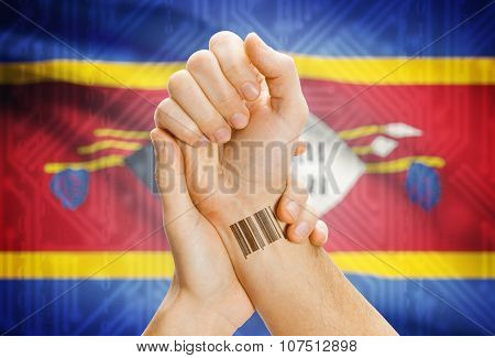 Barcode Id Number On Wrist And National Flag On Background - Swaziland