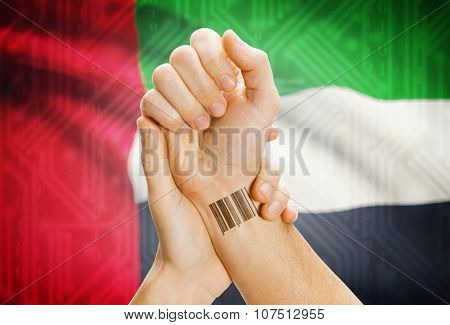 Barcode Id Number On Wrist And National Flag On Background - United Arab Emirates