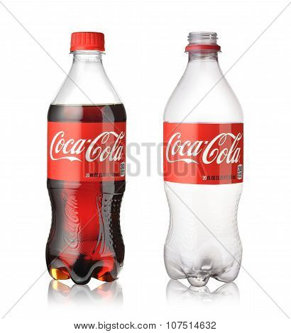 Empty And Full Coca Cola Bottles